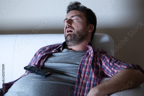 Obraz Portrait of one caucasian man watching tv - fototapety do salonu