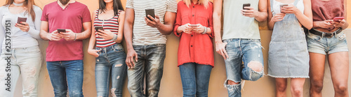 Fotografie, Obraz  Teenager friends watching videos on smartphones - Main focus on center hands