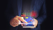 Business man is use touchscreen a Stock virtual hologram. Close up business man formal blue suit Use hold smart phone in the dark.