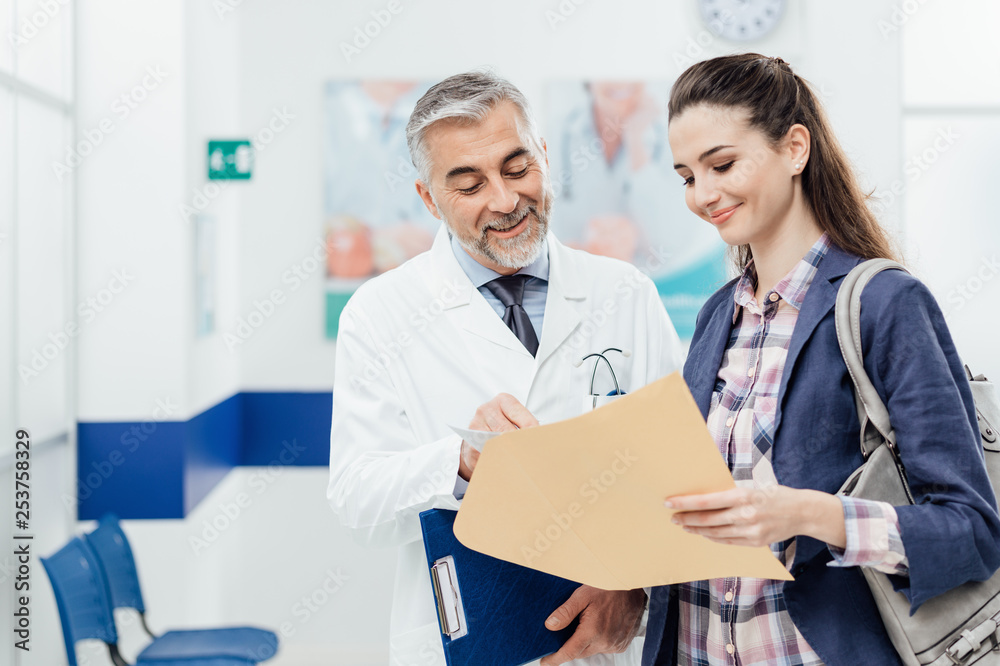 Fototapeta Doctor explaining medical records to his patient