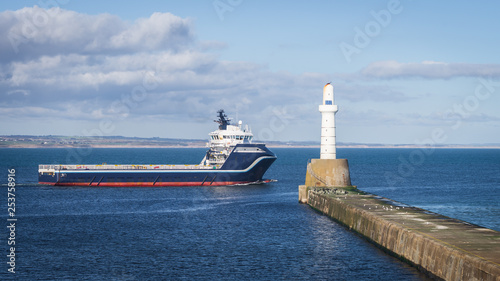 Offshore Supply Ship and Lighthouse Canvas-taulu