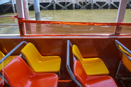 colorful chairs on a river boat in Bangkok Canvas Print