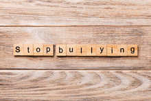 Stop Bullying Word Written On Wood Block. Stop Bullying Text On Wooden Table For Your Desing, Concept