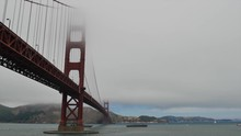Barge Passing Under The Golden Gate Bridge