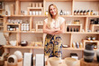 Leinwanddruck Bild - Portrait Of Female Owner Of Independent Cosmetics Store