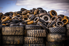 Pile Of Old Used Car And Truck Tyres In A Tire Dump Against An Afternoon Sky.  Victoria.