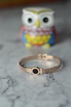 Rose Gold Bracelet On Marble Background