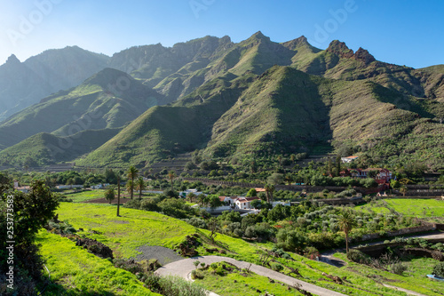 Spoed Foto op Canvas Canarische Eilanden Fertile valley with mango and oranges fruit plantations, vineyards and avocados orchards near Agaete, Gran Canaria, Canary islands, Spain