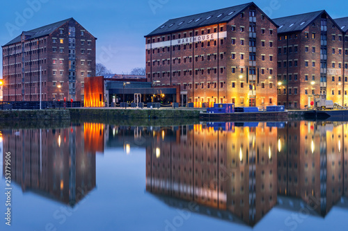 Valokuva  Gloucester docks warehouses reflected in quay on Sharpness Canal