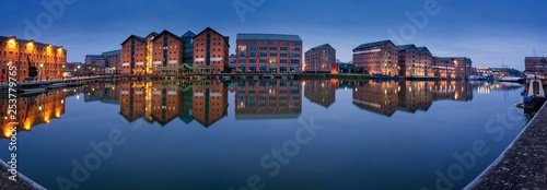 Fotografija Gloucester docks warehouses reflected in quay on Sharpness Cana