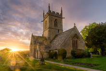 Sun Burst Over A Church In Willersey