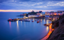 Tenby Harbour, Wales Just Before Sunrise, Boats And Buildings In Blue Hour.