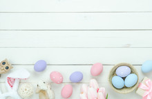 Table Top View Shot Of Decorations Happy Easter Holiday Background Concept.Flat Lay Bunny Eggs With Flower And Variety Decor On Modern Rustic White Wooden.Blank Space Design For Mock Up & Template.
