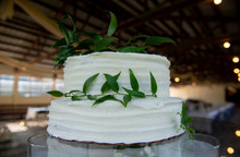 A Two Tiered White Wedding Cake