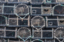 Detail Of Shellfish Traps Stacked On An English Quayside