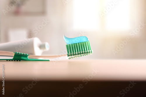 Fotografía  Concept oral hygiene with toothbrush on wood table in bathroom