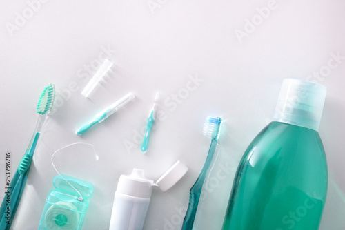 Valokuva  Equipment for oral hygiene on white table top general view