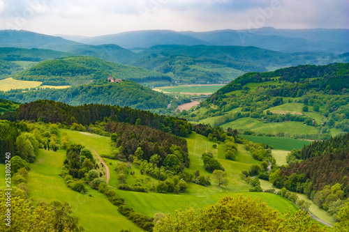 Recess Fitting Green blue Great panoramic landscape view at Hanstein Castle ruin which is surrounded by beautiful woodland, the Werra Valley and the Hessian low mountains. On the far left the Ludwigstein Castle can be seen.
