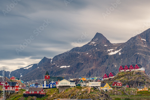 Sisimiut arctic village / town in Greenland with steep mountain slopes in the back - the end of Arctic Circle Trail