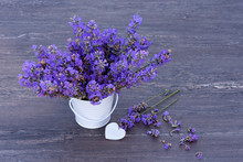 Fresh Lavender In A Small White Bucket And White Heart On Grey Wooden Background.