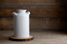 Mockup Of A White Vintage Milk Jug On A Brown Wooden Table.