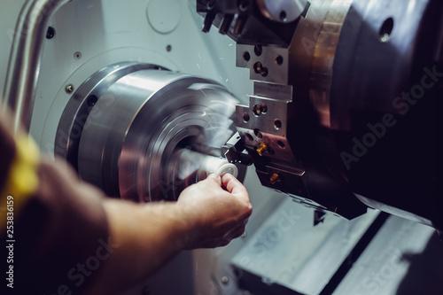 Fotografie, Obraz  Close up CNC milling machine working process on metal industry
