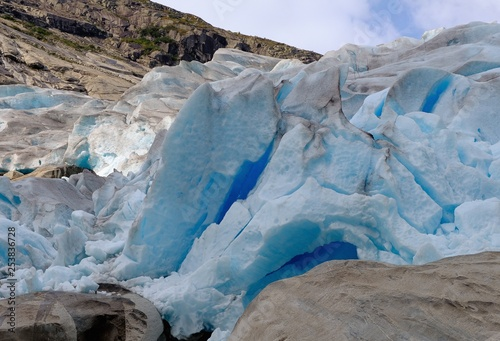 Poster Glaciers Happy Man walking at Nigardsbreen glacier Travel Lifestyle concept raised hands adventure extreme vacations outdoor nature in Norway