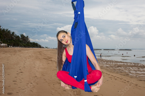 Fotografie, Obraz  Young woman practicing fly yoga asana outdoors