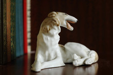 Porcelain Figurine Of A Dog Of...