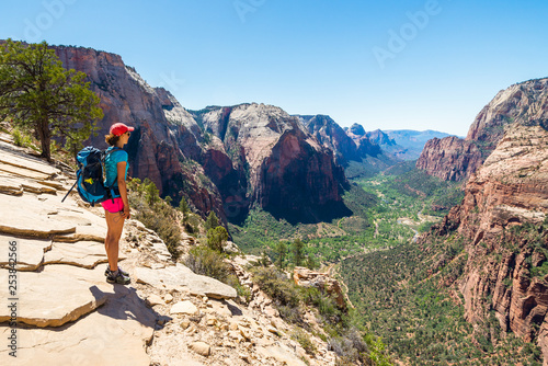 Fototapeta  Young woman is looking at the magnificent view from Angel's landing in Zion National park