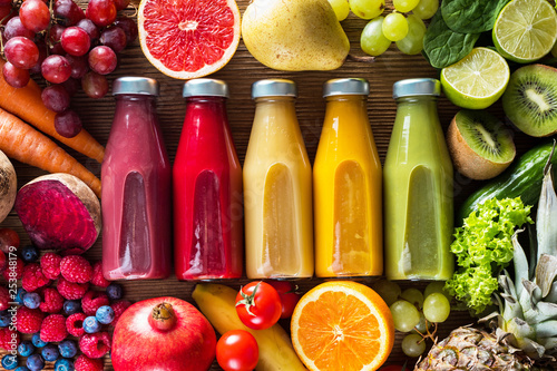 Foto auf Leinwand Saft Colorful smoothies in bottles