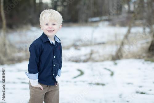 Fotografie, Obraz  adorable little boy posing in snow
