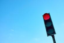 Red Traffic Light Against The Sky