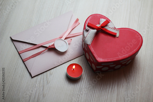 Romantic flatlay with candle, letter and box
