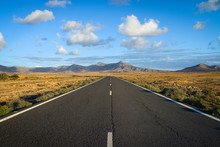 Spain, Canary Islands, Fuerteventura, Landscape With Empty Country Road