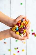 Colorful Sweet Jellybeans In Hands, Forming A Heart