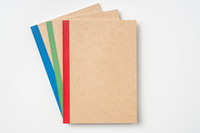 3 Kraft Notebook And Pen On White Background