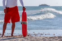 Lifeguard Holding Rescue Buoy ...