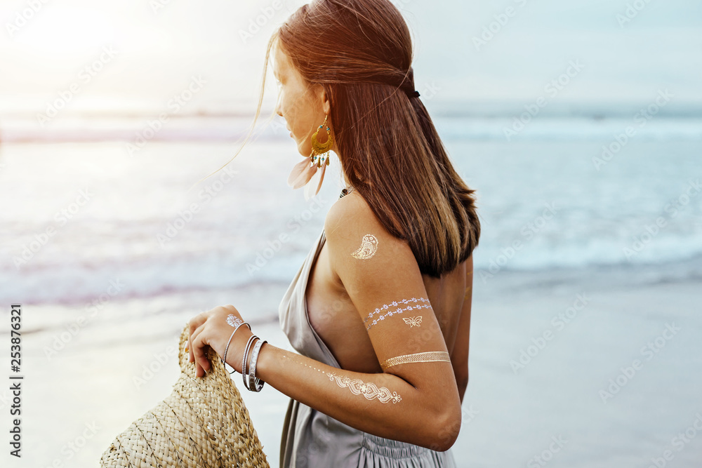 Fototapety, obrazy: Young girl with silver tattoo and boho jewelry on sunset