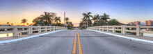 Bridge Roadway Over A Riverway That Leads To The Ocean On Marco Island