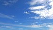 A clean smooth time lapse of a cloud formation in a bright blue sky.