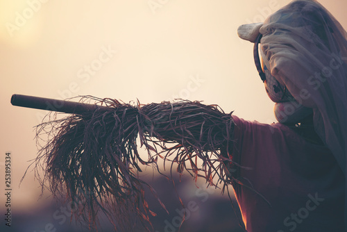 Foto auf Leinwand Grau Verkehrs scarecrow in the paddy rice field at sunset