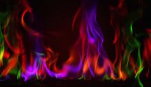 Multi Color Fire Flame Abstract On Black Background. A Mystic Colorful Smoke. Blurry Bright Abstraction With Colored Lines. Magic Fire