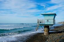 Blue Lifeguard Tower On A Rock...