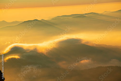 Wall Murals Beautiful morning Mountain landscape with winter fog at sunse of Ceahlau, Romaniat