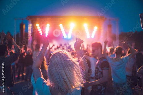 Obraz BAD AIBLING, GERMANY: girl in front of a stage on a festival in Mai 2017 - fototapety do salonu