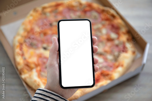 Stickers pour portes Pizzeria holding phone with isolated screen above pizza box