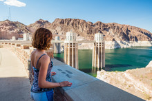 Young Woman Is Admiring The Colorado River From The Hoover Dam In Nevada / Arizona, United States Of America