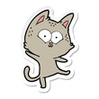 sticker of a cartoon cat dancing