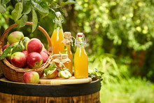 Apples On Background Orchard Standing On A Barrel. Apple Juice And Apple Preserves.